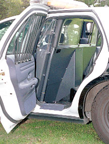 The Back Seat Of Ford Patrol Car Is Where Suspects Are Transported A Clear Plastic Divider Pictured In Lowered Position Slides And Separates