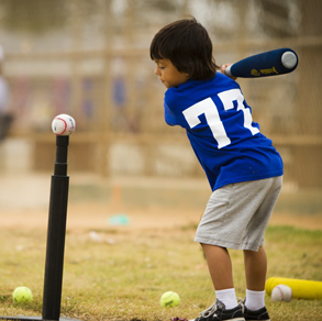 Pee Wee T-Ball player taking a swing at the ball